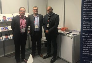 Tim Davies, Kevin J. Gray, and Walter J. Henderson, Jr., at the WES BETT Booth